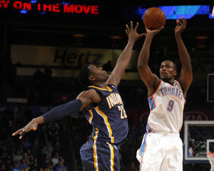 photo - Oklahoma City's Serge Ibaka (9) shoots over Indiana's Ian Mahinmi (28) during the NBA game between the Indiana Pacers and the Oklahoma City Thunder at the Chesapeake Energy Arena   Sunday,Dec. 9, 2012. Photo by Sarah Phipps, The Oklahoman