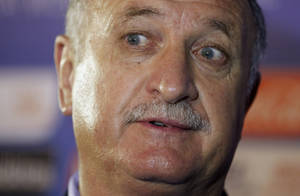 Photo - Brazil head coach Luiz Felipe Scolari answers journalists' questions after the draw ceremony for the 2014 soccer World Cup in Costa do Sauipe near Salvador, Brazil, Friday, Dec. 6, 2013. (AP Photo/Victor R. Caivano)