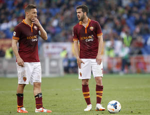 Photo - Roma midfielder Miralem Pjanic, of Bosnia, right, talks to teammate Francesco Totti, left, during a Serie A soccer match between Roma and Parma, at Rome's Olympic stadium, Wednesday, April 2, 2014. (AP Photo/Riccardo De Luca)