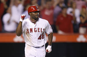 Photo -   Los Angeles Angels' Torii Hunter pumps his fist after hitting a RBI-single to win the game against the Seattle Mariners during the ninth inning of a baseball game in Anaheim, Calif., Wednesday, Sept. 26, 2012. The Angels won 4-3. (AP Photo/Jae C. Hong)