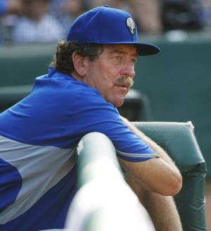 Photo - Las Vegas 51's pitching coach Frank Viola leans on the rail of the dugout during the minor league baseball game between the Oklahoma City Redhawks and the Las Vegas 51s at the Chickasaw Bricktown Ballpark on Sunday, June 15,  2014. In his playing career, Viola won the AL Cy Young Award in 1988 and World Series MVP in 1987. Photo by KT King, The Oklahoman