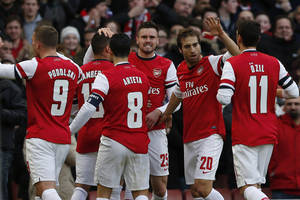 Photo - Arsenal's Alex Oxlade-Chamberlain, second left, celebrates his goal against Liverpool with teammates during their English FA Cup fifth round soccer match at Emirates Stadium in London, Sunday, Feb. 16, 2014. (AP Photo/Sang Tan)