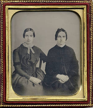 Photo - This photo released by Amherst College Archives and Special Collections, and the Emily Dickinson Museum, in Amherst, Mass., shows a copy of a circa 1860 daguerreotype purported to show a 30-year-old Emily Dickinson, left, with her friend Kate Scott Turner. The image was displayed during the August 2012 Emily Dickinson International Society conference held at Case Western Reserve University in Cleveland.  AP Photo/Amherst College Archives and Special Collections, and the Emily Dickinson Museum <strong></strong>
