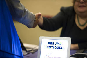 Photo - FILE -  In this Thursday, May 30, 2013, photo, a job seeker stops at a table offering resume critiques during a job fair held in Atlanta. The Labor Department releases weekly jobless claims on Thursday, Feb. 27, 2014. (AP Photo/John Amis, File)