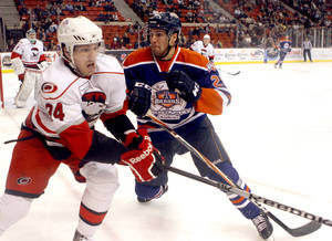 Photo - Oklahoma City's Chris VandeVelde defends against Charlotte's Justin Shugg during the AHL game between the Oklahoma City Barons and the Charlotte Checkers at the Cox Convention Center in Oklahoma City, Friday, Feb. 3, 2012. Photo by Sarah Phipps, The Oklahoman ORG XMIT: KOD