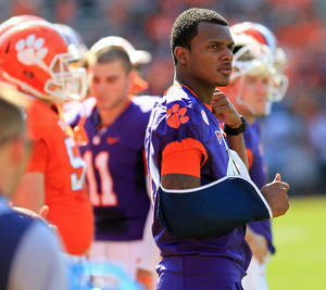 Photo - Clemson freshman quarterback Deshuan Watson, with his arm in a sling, watches the NCAA college football team's spring game Saturday, April 12, 2014, in Clemson, S.C. (AP Photo/Anderson Independent-Mail, Mark Crammer) SENECA JOURNAL OUT  GREENVILLE NEWS OUT