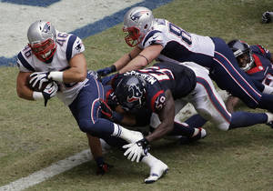 Photo - New England Patriots' James Develin (46) scores a touchdown against the Houston Texans during the third quarter of an NFL football game on Sunday, Dec. 1, 2013, in Houston. (AP Photo/David J. Phillip)