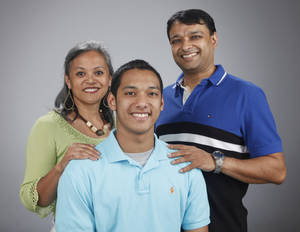 Photo - HIGH SCHOOL SWIMMING / JOCELYN NAIK / FAMILY: All-City Swimmer Naresh Naik with his parents Jocelyn and Kam Naik at OPUBCO studio Monday April 2, 2012. Photo by Doug Hoke, The Oklahoman