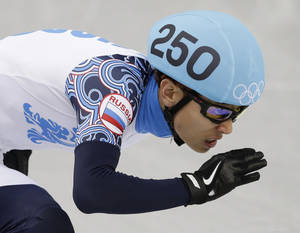 Photo - Victor An of Russia competes in a men's 500m short track speedskating heat at the Iceberg Skating Palace during the 2014 Winter Olympics, Tuesday, Feb. 18, 2014, in Sochi, Russia. (AP Photo/Darron Cummings)