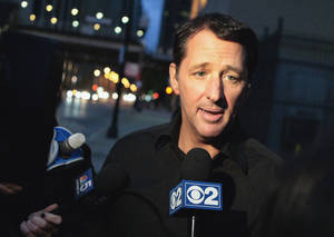 Photo - FILE - In this Oct. 28, 2013 file photo, television infomercial pitchman Kevin Trudeau speaks to the media after leaving the Metropolitan Correctional Center in downtown Chicago. On Monday, March 17, 2014, a federal judge in Chicago sentenced Trudeau to 10 years in prison for bilking consumers via infomercials for his best-selling weight loss book. (AP Photo/Sun-Times Media, Michael Jarecki) MANDATORY CREDIT, MAGS OUT, NO SALES