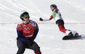 Photo - Czech Republic's Eva Samkova, left,  celebrates after taking the gold medal in the women's snowboard cross final, ahead of silver medalist Dominique Maltais of Canada, right, at the Rosa Khutor Extreme Park, at the 2014 Winter Olympics, Sunday, Feb. 16, 2014, in Krasnaya Polyana, Russia. (AP Photo/Andy Wong)