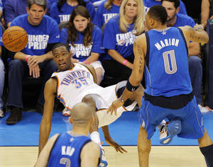 Photo - Oklahoma City's Kevin Durant (35) falls down after being fouled by Shawn Marion (0) of Dallas as Jason Kidd (2) looks on in the second half during game 3 of the Western Conference Finals of the NBA basketball playoffs between the Dallas Mavericks and the Oklahoma City Thunder at the OKC Arena in downtown Oklahoma City, Saturday, May 21, 2011. Dallas won, 93-87. Photo by Nate Billings, The Oklahoman