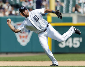 Photo - Detroit Tigers shortstop Jhonny Peralta throws out Boston Red Sox's Shane Victorino at first base on a ground ball in the sixth inning of a baseball game on Sunday, June 23, 2013, in Detroit. (AP Photo/Duane Burleson)