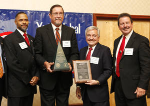 Photo - Marcus Verner, director of the Oklahoma U.S. Export Assistance Center, Paul Schatte, co-owner of Head Country Food Products Inc., Secretary of Commerce Dave Lopez and Chuck Mills, chairman of the Oklahoma District Export Council, as a Governor's Award for Excellence in Exporting is presented Thursday to Ponca City-based Head Country during the 2013 Oklahoma World Trade Conference in Midwest City. Photo by Paul B. Southerland, The Oklahoman