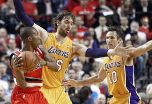 Photo -   Portland Trail Blazers guard Nolan Smith, left, looks for help as Los Angeles Lakers' Pau Gasol, middle, and Steve Nash defend during the first quarter of an NBA basketball game in Portland, Ore., Wednesday, Oct. 31, 2012. (AP Photo/Don Ryan)
