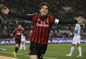 Photo - FILE - In this March 23, 2014 file photo, AC Milan's Kaka celebrates after he scored during a soccer match against Lazio at Rome's Olympic Stadium. Kaka has ended his contract with AC Milan, leaving him free to sign with Orlando City Soccer Club. Kaka will fly to the United States on Monday night, June 30, 2014, to sign with the new Major League Soccer franchise. (AP Photo/Andrew Medichini, File)