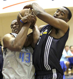 Photo - Orlando's Daniel Orton, left, was ejected from his professional debut Monday in the Orlando summer league. AP PHOTO