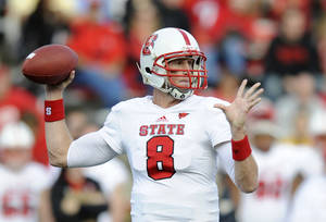 Photo -   North Carolina State quarterback Mike Glennon (8) throws a pass against Maryland during the first half of an NCAA football game, Saturday, Oct. 20, 2012, in College Park, Md. (AP Photo/Nick Wass)