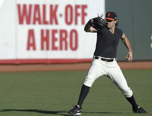 Photo -   San Francisco Giants pitcher Barry Zito winds up during a voluntary practice in preparation for Sunday's Game 6 of the National League championship baseball series against the St. Louis Cardinals, Saturday, Oct. 20, 2012, in San Francisco. (AP Photo/Ben Margot)