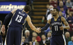 Photo - Memphis Grizzlies forward Mike Miller, left, congratulates teammate Mike Conley after Conley scored against the Sacramento Kings during the fourth quarter of an NBA basketball game in Sacramento, Calif., Wednesday, Jan. 29, 2014.  The Grizzlies won 99-89.(AP Photo/Rich Pedroncelli)