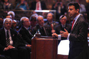 Photo - Louisiana Gov. Bobby Jindal speaks during the opening of the state legislature at the state capitol in Baton Rouge, La., Monday, March 10, 2014. (AP Photo/Hilary Scheinuk)