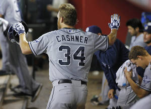 Photo - San Diego Padres players playfully ignore pitcher Andrew Cashner (34) as he looks for high fives in the dugout after he hit a solo home run during the sixth inning of a baseball game against the Arizona Diamondbacks, Saturday, July 27, 2013, in Phoenix. (AP Photo/Matt York)