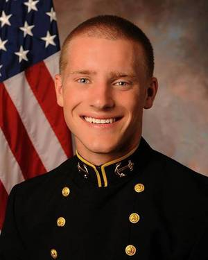 Photo - This photo provided by the U.S. Naval Academy shows Navy football player Will McKamey, who has been hospitalized since collapsing at practice three days ago, died Tuesday March 25, 2014 while in a coma. He was 19. (AP Photo/U.S. Naval Academy)