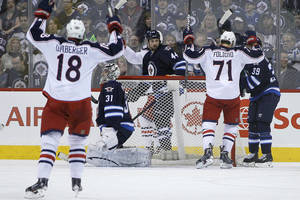 Photo - Columbus Blue Jackets' Nick Foligno (71) and RJ Umberger (18) celebrate Foligno's goal against the Winnipeg Jets goaltender Ondrej Pavelec (31), Zach Bogosian (44) and Tobias Enstrom (39) during second period of an NHL hockey game in Winnipeg, Manitoba, on Saturday, Jan. 11, 2014. (AP Photo/The Canadian Press, John Woods)