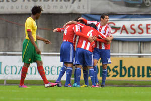 Photo - Paraguay's players celebrate after scoring, during their friendly soccer match against Cameroon in Kufstein, Austrian province of Tyrol, Thursday, May 29. 2014. (AP Photo/Kerstin Joensson)