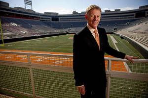 Photo - OKLAHOMA STATE UNIVERSITY / OSU: Oklahoma State athletic director Mike Holder poses for a portrait inside Boone Pickens Stadium in Stillwater, Okla., Tuesday, March 16, 2011. Photo by Bryan Terry, The Oklahoman ORG XMIT: KOD