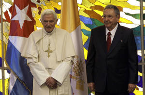 Photo - Cuba's President Raul Castro, right, and Pope Benedict XVI attend a meeting in Havana, Cuba, Tuesday, March 27, 2012. The meeting took place behind closed doors on the pontiff's second day on the island. (AP Photo/Ismael Francisco, Cubadebate) ORG XMIT: XDJ101