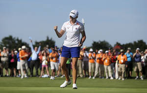 Photo - Stacy Lewis celebrates her win after a putt on the 18th hole of the final round at the ShopRite LPGA Classic golf tournament in Galloway Township, N.J., Sunday, June 1, 2014. (AP Photo/Mel Evans)
