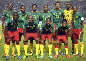 Photo - FILE - In this Oct. 13, 2013 file photo, Cameroon soccer team poses prior to the start the World Cup qualifying soccer between Tunisia and Cameroon in Tunis, Tunisia. Foreground from left: Tchounko Nounke, Kouamo Webo, Takang Enouh Eyong and Jean Makoun. Background from left: Allan Romeo Nyom, Bilong Song, Ndoubena Nkoulou, Fongang Chedjou, Job Mtip Joel and Samuel Etoo.  (AP Photo/Salah Habibi, File)