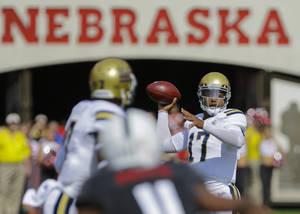 Photo - UCLA quarterback Brett Hundley (17) looks for a receiver in the first half of an NCAA college football game against Nebraska in Lincoln, Neb., Saturday, Sept. 14, 2013. (AP Photo/Nati Harnik)