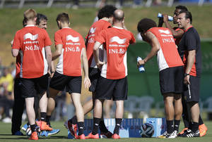 Photo - Belgium's head coach Marc Wilmots, right, talks with his players during a team training session in Mogi Das Cruzes, Brazil, Friday, June 13, 2014. Belgium play in group H of the 2014 soccer World Cup. (AP Photo/Andrew Medichini)