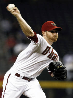 Photo -   Arizona Diamondbacks' Ian Kennedy throws against the Los Angeles Dodgers during the first inning of a baseball game, Tuesday, Sept. 11, 2012, in Phoenix. (AP Photo/Ross D. Franklin)