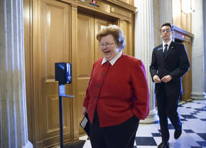 Photo - FILE - This March 24, 2014 file photo shows Senate Appropriations Committee Chair Sen. Barbara Mikulski, D-Md. walking on Capitol Hill in Washington. A bipartisan coalition on the Senate Appropriations Committee moved Thursday to roll back House GOP-backed cuts to Amtrak, transportation projects, and affordable housing projects, but pressures elsewhere in the budget may make the funding levels unsustainable as the massive $108 billion spending bill moves ahead. (AP Photo/J. Scott Applewhite, File)
