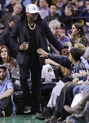 Photo -   Boston Red Sox designated hitter David Ortiz is greeted by fans during half time of a basketball game between the Boston Celtics and Milwaukee Bucks in Boston, Friday, Nov. 2, 2012. (AP Photo/Charles Krupa)