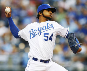Photo - Kansas City Royals starting pitcher Ervin Santana (54) delivers to a Los Angeles Angels batter during the first inning of a baseball game at Kauffman Stadium in Kansas City, Mo., Thursday, May 23, 2013. (AP Photo/Orlin Wagner)