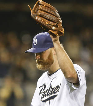 Photo - San Diego Padres starting pitcher Andrew Cashner acknowledges at the standing ovation from the fans as he leaves the game against the Colorado Rockies in the eighth inning of a baseball game Wednesday, April 16, 2014, in San Diego.  Cashner pitched seven and a third innings and allowed two runs while striking out five.   (AP Photo/Lenny Ignelzi)