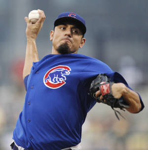 photo - FILE - In this Aug. 3, 2011, file photo, Chicago Cubs pitcher Matt Garza delivers during the second inning of a baseball game against the Pittsburgh Pirates in Pittsburgh. Jeff Samardzija will be the opening-day starter for the Cubs, who said Garza will start the season on the disabled list because of an injured muscle in his side that is preventing the right-hander from throwing. (AP Photo/Gene J. Puskar, File)
