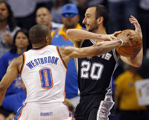 photo - Oklahoma City's Russell Westbrook (0) pressure's San Antonio's Manu Ginobili (20) in the second half during Game 4 of the Western Conference Finals between the Oklahoma City Thunder and the San Antonio Spurs in the NBA playoffs at the Chesapeake Energy Arena in Oklahoma City, Saturday, June 2, 2012. Oklahoma City won, 109-103. Photo by Nate Billings, The Oklahoman