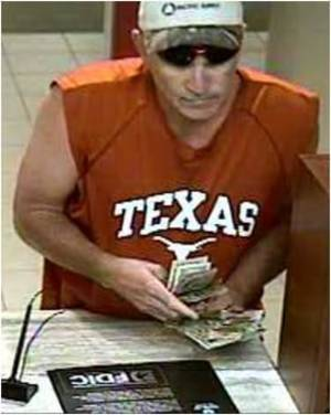 Photo -  Surveillance photo of a man wanted for bank robbery by the FBI. Photo provided  <strong> -   </strong>