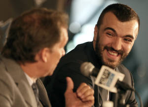 Photo - Nikola Pekovic, of Montenegro, smiles during a news conference as Minnesota Timberwolves President Flip Saunders looks on at left, Friday, Aug. 16, 2013 in Minneapolis. The Timberwolves signed Pekovic to a five-year deal that could be worth as much as 468 million.  (AP Photo/The Star Tribune, Bruce Bisping)  MANDATORY CREDIT; ST. PAUL PIONEER PRESS OUT; MAGS OUT; TWIN CITIES TV OUT  MBO TV is soft out
