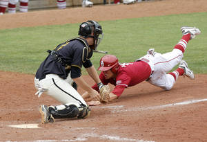 photo - Oklahoma's Caleb Bushyhead is tagged out by Missouri's Ben Turner during the Big 12 baseball championship game between the University of Oklahoma and Missouri at the Chickasaw Bricktown Ballpark in Oklahoma City,  Sunday, May 27, 2012. Photo by Sarah Phipps, The Oklahoman.