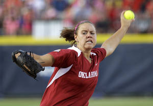 photo - FILE - In this June 5, 2012, file photo, Oklahoma's Keilani Ricketts pitches against Alabama in the fourth inning of an NCAA Women's College World Series softball game in Oklahoma City.  Bama and runner-up Oklahoma are among the favorites to once again contend for the Women's College World Series in a sport that's more wide open than ever.(AP Photo/Sue Ogrocki, File) ORG XMIT: OKSO203