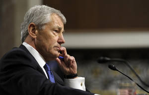 photo - Republican Chuck Hagel, President Obama's choice for defense secretary, testifies before the Senate Armed Services Committee during his confirmation hearing, on Capitol Hill in Washington, Thursday, Jan. 31, 2013.  (AP Photo/Susan Walsh)
