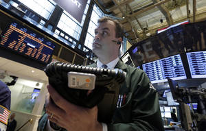photo - In this Tuesday, Feb. 26, 2013, photo,  Trader William Lawrence works on the floor of the New York Stock Exchange.Futures are rising as Chairman Ben Bernanke heads to Capitol Hill to explain what the Federal Reserve will do to accelerate the economic recovery.  (AP Photo/Richard Drew)
