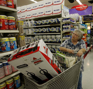 Photo - Nina Wilson shops at Walmart in Paramount, Calif.  AP Photo