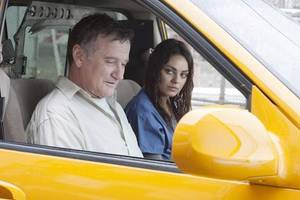 Henry Altmann (Robin Williams) and Sharon Gill (Mila Kunis) in THE ANGRIEST MAN IN BROOKLYN.